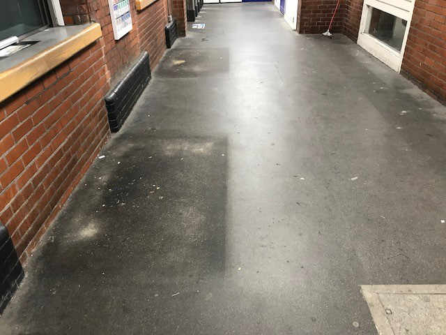 The booking hall floor before cleaning