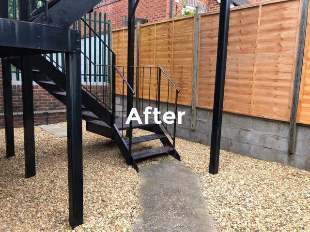 Grounds maintenance and repair at Kee Resources - the fire escape, fence and new gravel surface after cleaning and repair